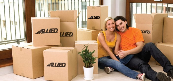 Couple with Allied moving boxes